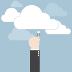 Businessman hand connecting cable to the cloud, Cloud computing