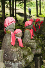 jizo statues with walker in background