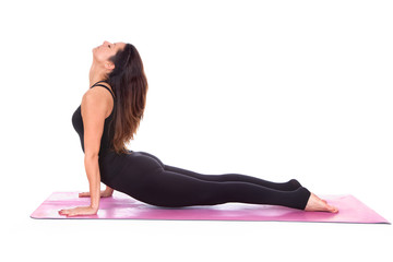 Beautiful woman doing cobra pose on yoga class