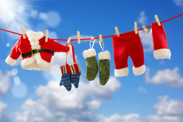 Clothing Santa's on the rope.
