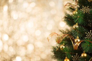 Christmas tree background with gold light