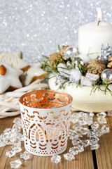 White candle holder with oriental ornaments