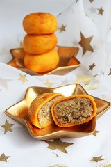 Christmas sweets (peach stuffed with nuts)
