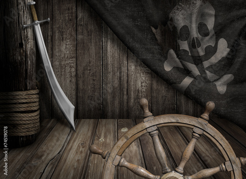 Pirates ship steering wheel with old jolly roger flag and saber