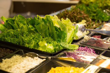 salad bar, green fresh vegetable on salad bar corner