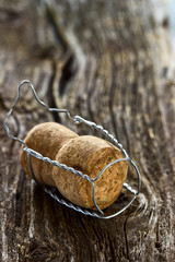 Champagne cork on a wooden board