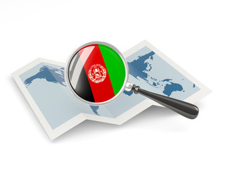 Magnified flag of afghanistan with map