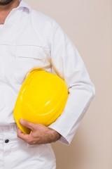 Handyman holding his yellow helmet