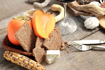 winter gourmet composition with persimmon, cereal  bread and nou