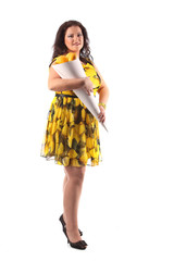 Plus size model posing like fashion models with lime