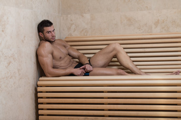 Man Resting Relaxed In The Hot Sauna