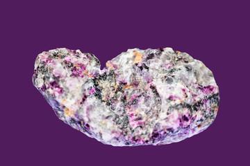Pegmatite pink tourmalines on  dark purple  background