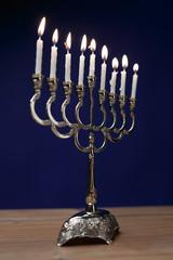 Hanukkah menorah with candles.