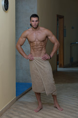 Wet Muscular Sexy Man Wrapped In Towel