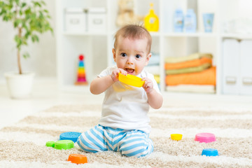 baby boy playing with toys indoor