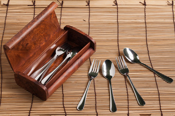 Wooden cutlery box on wood background.