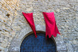 Red flags over the gates fortresses in San Marino. The Republic