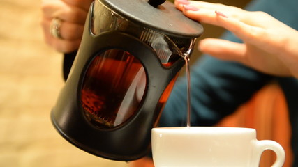 Tea in a teapot French - Press Female hands