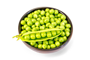 Green peas in brown bowl with pod