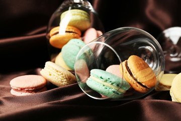 Gentle colorful macaroons in wine glass