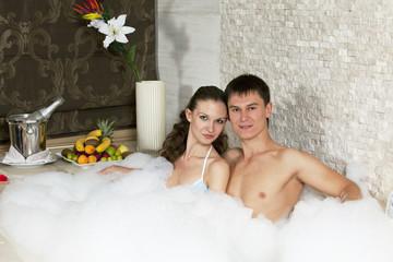 Beautiful couple enjoying in jacuzzi.