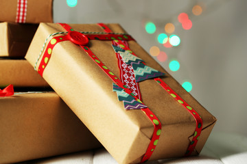 Hand-made Christmas gifts on bokeh background