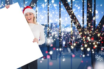 Composite image of festive blonde showing poster
