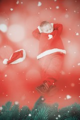 Composite image of little boy napping in santa costume