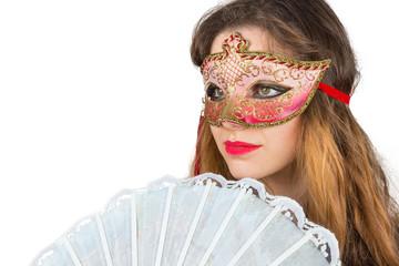 Ragazza con maschera di carnevale