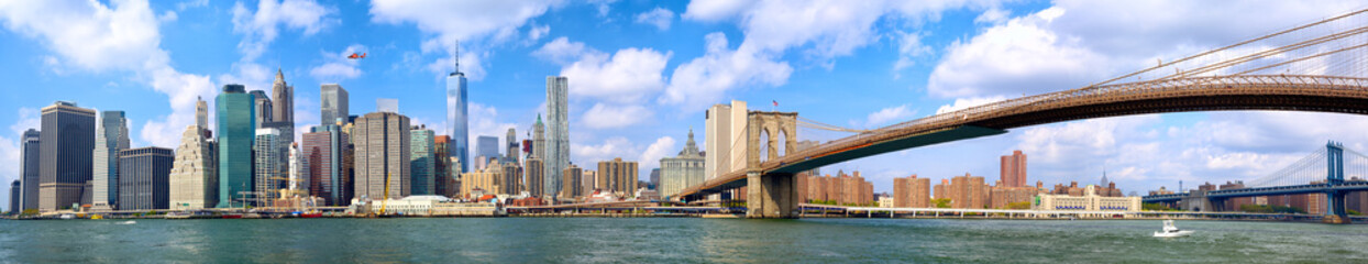 Manhattan skyline and Brooklyn Bridge panorama in New York