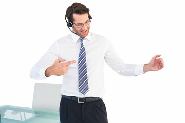 Businessman using a headset while presenting something