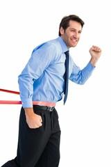 Happy businessman crossing finishing line