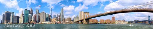 Manhattan skyline and Brooklyn Bridge panorama in New York