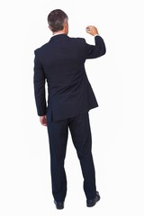 Rear view of a businessman drawing with a chalk