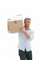 Smiling man carrying cardboard box