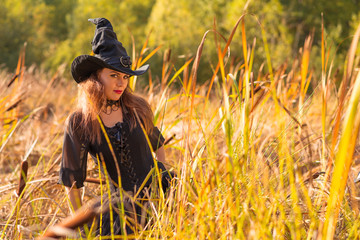 woman in witch's hat looking at camera