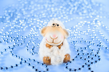 toy sheep in the background blue beads