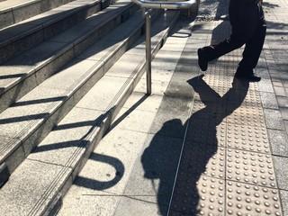 man walking down the step