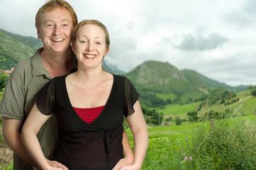 Happy couple in green fields