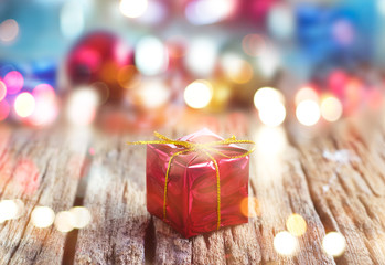 Abtract colorful gift boxes on wooden background, soft and blur