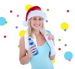 Composite image of festive fit blonde smiling at camera