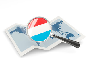 Magnified flag of luxembourg with map