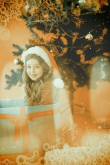 Composite image of festive little girl sitting in large gift