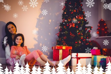Composite image of mother and daughter waiting for santa claus