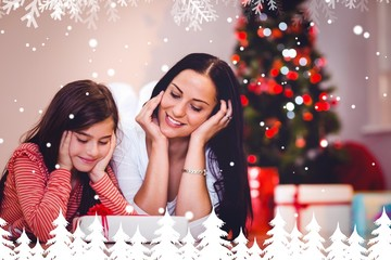 Composite image of festive mother and daughter smiling at gift