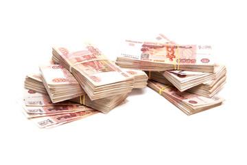 Пачки российских денег на белом фоне
