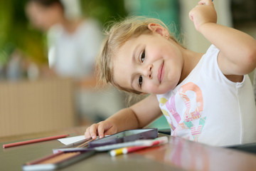 Cute little girl making drawings