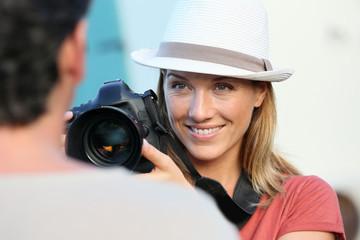Portrait of woman photographer guiding model
