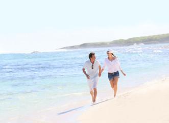 Couple running on a Caribbean beach