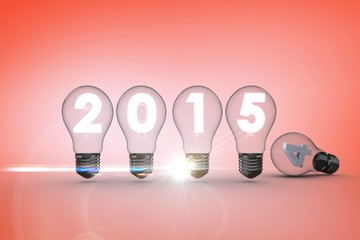 Composite image of 2015 with light bulb